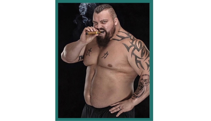 A picture of world's strongest man Eddie Hall smoking a cigar